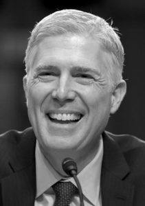 SUPREME COURT Justice nominee Neil Gorsuch smiles as he testifies on Capitol Hill in Washington Tuesday during his confirmation hearing before the Senate Judiciary Committee.