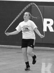 SYDNEY UNDERHILL-TILTON jumps rope during softball practice at Richmond High School on Tuesday.