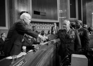 """SENATE ARMED SERVICES COMMITTEE CHAIRMAN SEN. JOHN MCCAIN, R-Ariz., left, welcomes Marine Corps Commandant Gen. Robert B. Neller, center, and Sgt. Major of the Marine Corps Ronald L. Green on Capitol Hill in Washington, Tuesday, prior to the start of the committee's hearing on the investigation of nude photographs of female Marines and other women that were shared on the Facebook page """"Marines United."""""""