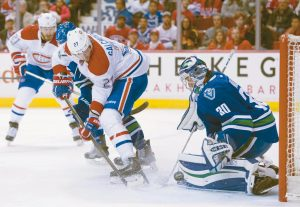 MONTREAL CANADIENS center Alex Galchenyuk (27) tries to get a shot past Vancouver Canucks goalie Ryan Miller (30) during first period NHL hockey action in Vancouver, British Columbia, on Tuesday. The Habs won in overtime, 2-1.