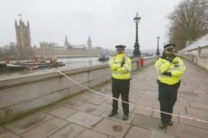 POLICE GUARD an area today on the embankment near Britain's Houses of Parliament, in background, in London. On Wednesday, a man went on a deadly rampage, first driving a car into pedestrians then stabbing a police officer to death before being fatally shot by police.