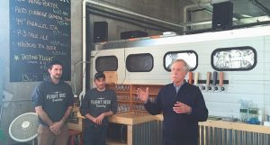 SEN. ANGUS KING, I-Maine, right, was on hand last Thursday for the grand opening of Flight Deck Brewing at Brunswick Landing. King remarked upon his love for beer and the continued revitalization of Brunswick Landing, and took part in the ribbon-cutting ceremony. Also pictured are co-owners Jared Entwisle, left, and Nate Wildes.