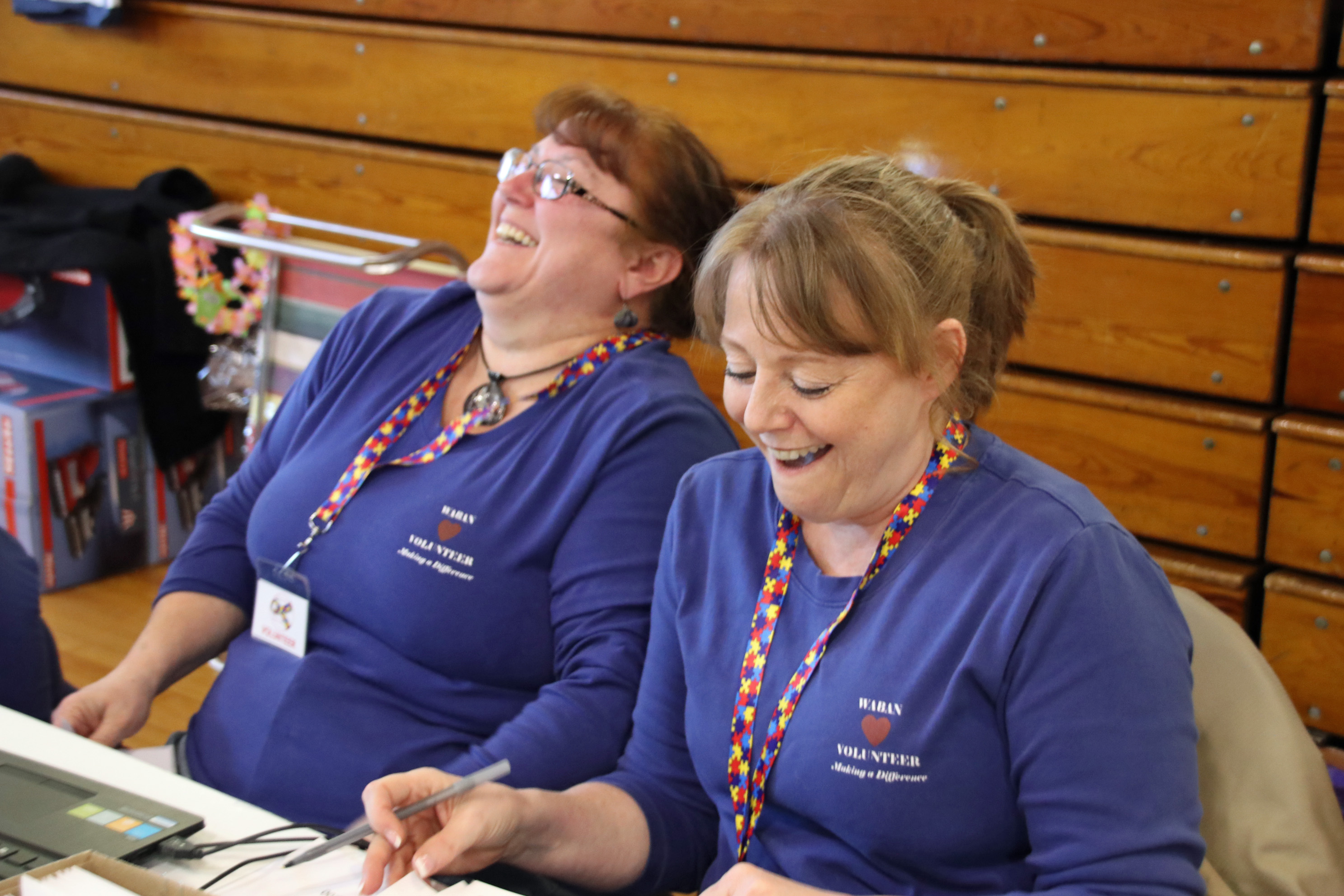 """Sisters Mary Nason and Debbie Treves share a laugh Saturday at Waban Telethon, there they both volunteer. Pitching in to help Waban began early in their lives, when their  childhood Sanford neighborhood organized  fundraisers like their own """"Olympic"""" games to help the programs. TAMMY WELLS/Journal Tribune"""