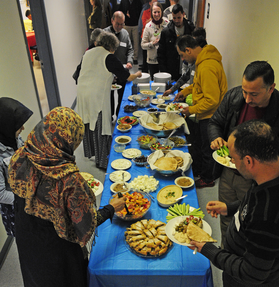A buffet Saturday at a church in Augusta was the starting point for residents and city officials considering how to make a proposed community center for immigrants a reality.