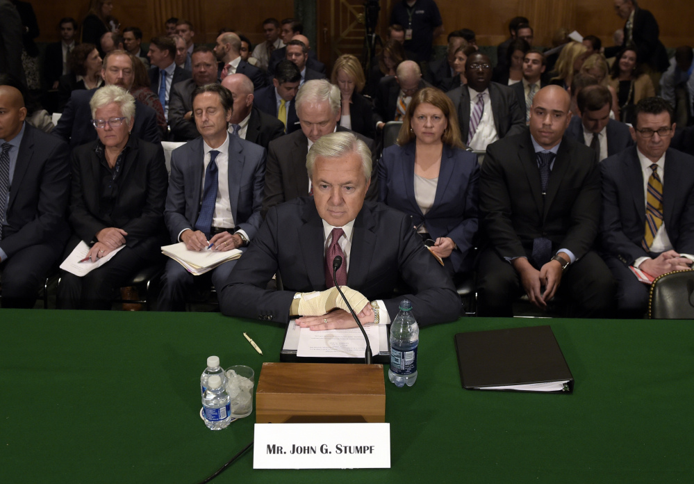 "Wells Fargo's then-CEO John Stumpf testifies before the Senate Banking Committee last September about fake accounts created by bank employees to meet sales goals. Stumpf was an optimist ""who refused to believe that the sales model was seriously impaired,"" a directors' report says."
