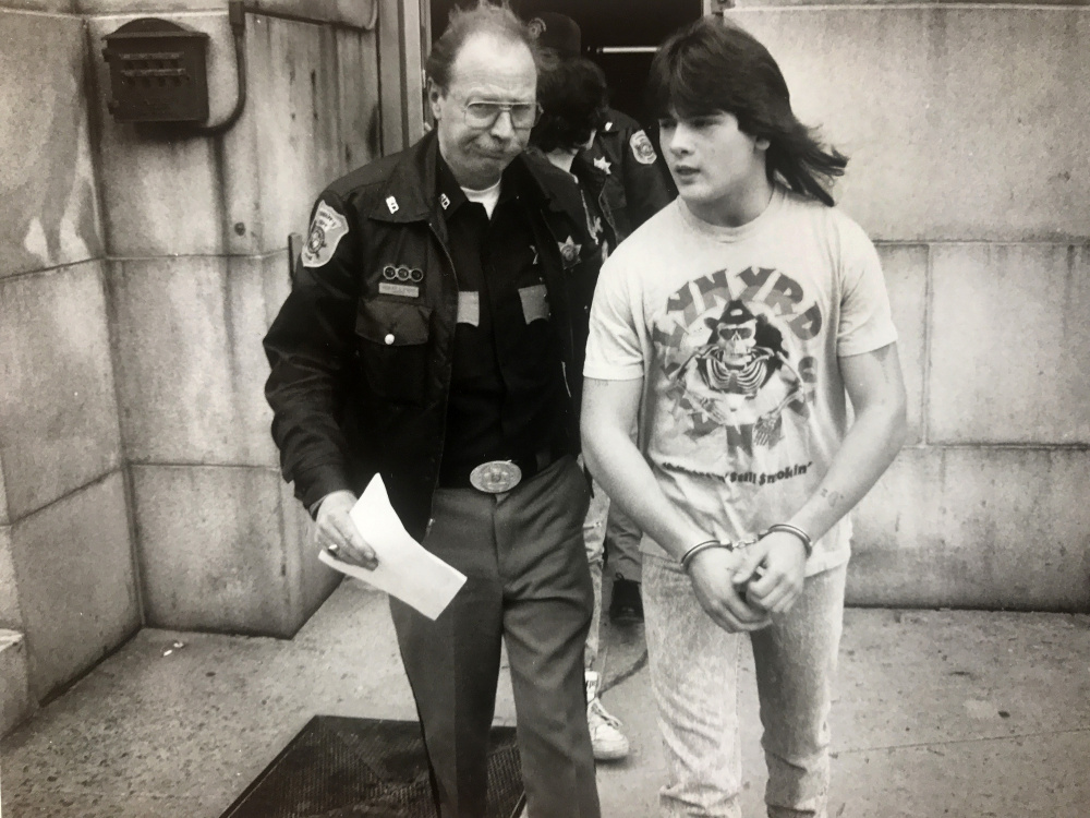 Anthony Sanborn Jr. is led from the Cumberland County Courthouse in April 1990 while waiting to be arraigned on a murder charge in the slaying of Jessica L. Briggs.