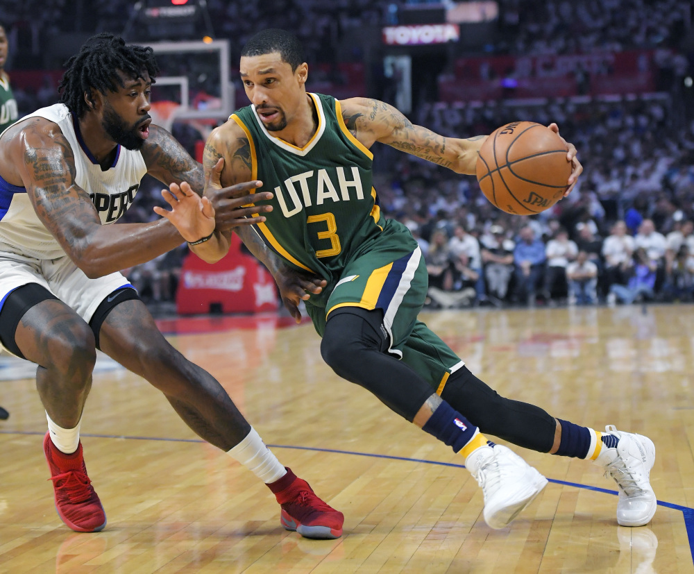 Utah guard George Hill drives past Clippers center DeAndre Jordan during Game 7 of their first-round playoff series Sunday in Los Angeles. Utah won, 104-91, and will face Golden State in the second round. (Associated Press/Mark J. Terrill)