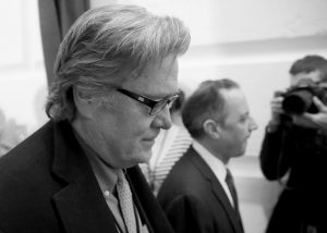 WHITE HOUSE CHIEF STRATEGIST STEVE BANNON, left, walks on Capitol Hill in Washington. President Donald Trump removed Bannon from the National Security Council, reversing an earlier controversial decision to give Bannon access to the high-level meetings.