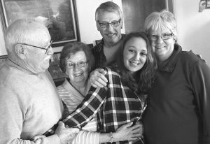 JAMIE SMITH, center, is flanked by her adoptive grandparents Don and Gloria Snyder, left, and adoptive parents LeeAnn and Dale Smith, right, at the Smith family home in Jerry City, Ohio.