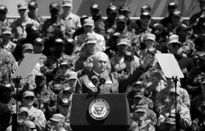 U.S. VICE PRESIDENT MIKE PENCE, front, waves to U.S. servicemen and Japanese Self-Defense Forces personnel on the flight deck of U.S. navy nuclear-powered aircraft carrier USS Ronald Reagan, at the U.S. Navy's Yokosuka base in Yokosuka, south of Tokyo, Wednesday.
