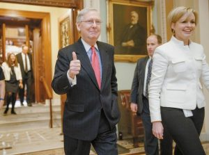 SENATE MAJORITY LEADER MITCH MCCONNELL of Kentucky signals a thumbs-up as he leaves the Senate chamber on Capitol Hill in Washington Thursday after he led the GOP majority to change Senate rules and lower the vote threshold for Supreme Court nominees from 60 votes to a simple majority in order to advance Neil Gorsuch to a confirmation vote.