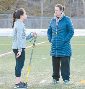 JESS AVERY (right) chats with one of her players at practice.