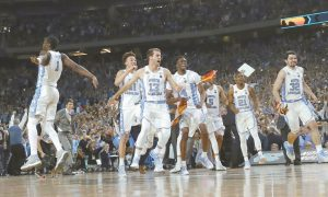 NORTH CAROLINA PLAYERS celebrate after the finals of the Final Four NCAA college basketball tournament against Gonzaga on Monday, in Glendale, Ariz. North Carolina won, 71-65.