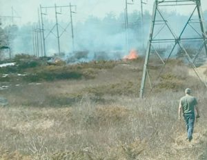 A FIRE caused by a failed isolator on a high tension power line burned 6.2 acres off Mountain Road in Woolwich Tuesday afternoon.