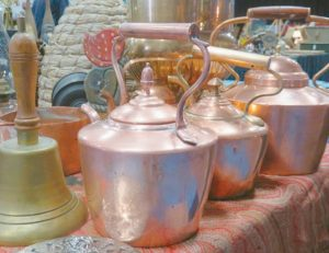 A COLLECTION OF COPPER POTS was among the antiques at the Bath Antique Sale in March.