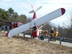 Crews wait for the FAA to arrive at the scene of a small plane crash on I-295 southbound in Bowdoinham Tuesday morning. DARCIE MOORE/THE TIMES RECORD