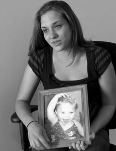 TRISTA REYNOLDS holds a photo of her daughter, Ayla Reynolds, during an interview with the Associated Press in Westbrook in 2013. Reynolds' daughter went missing in December of 2011.