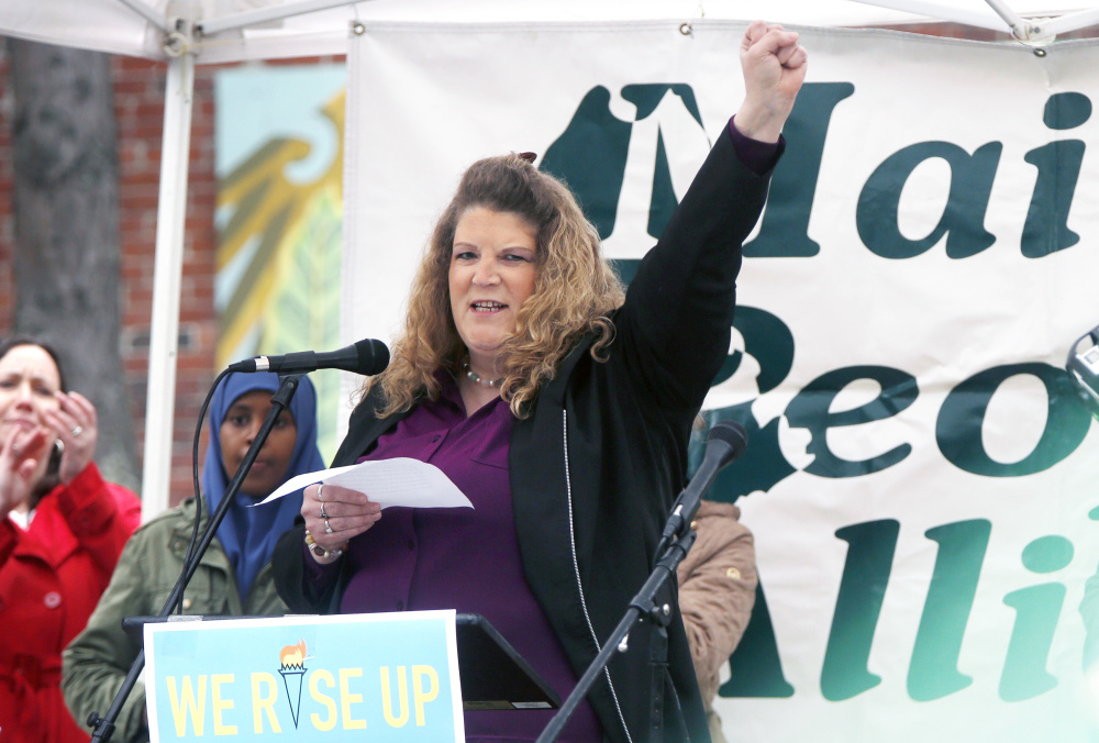 Sandra Scribner Merlim, whose husband, Otto Morales-Caballeros, was detained by U.S. Immigration and Customs Enforcement agents April 12, speaks May 1 during a rally for immigrants at Congress Square Park in Portland.