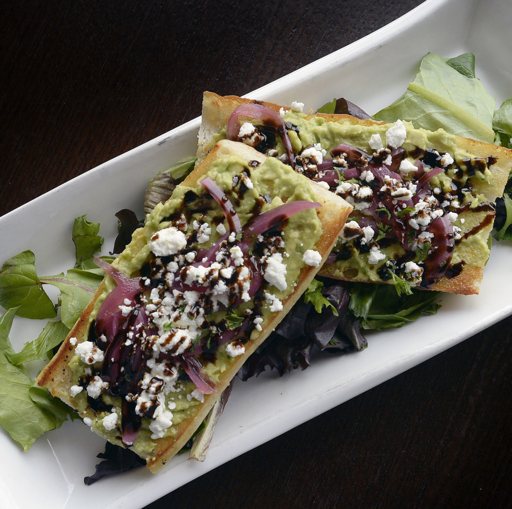 """At Ri Ra in Portland, the avocado toast that is popular with millennials comes on a """"grilled ... baguette with crunchy pickled red onion & tangy goat cheese"""" for $9."""