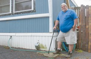 TODD ALEXANDER poses at his mobile home in Milton, Vt., that he heats with the help of the Low Income Heating Home Energy Assistance Program.