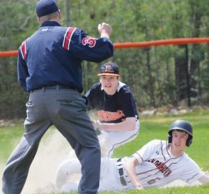 BRUNSWICK SECOND BASEMEN Kyle Hanson, center, and Skowhegan base runner Michael Berry look at the umpire on a close play at second base on Saturday. Berry was out, but Skowhegan downed the Dragons, 6-0.