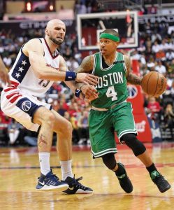 BOSTON CELTICS guard Isaiah Thomas (4) dribbles against Washington Wizards center Marcin Gortat (13) during the second half in Game 4 of a second-round NBA basketball playoff series on Sunday in Washington.