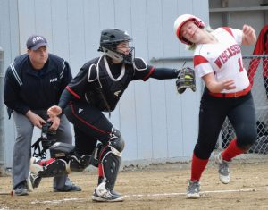 LISBON CATCHER Jasmin Le, center, puts the tag on Wiscasset base runner Farrah Casey in the second inning of Wednesday's MVC high school softball contest in Lisbon. Casey was out on the play, and Le's Greyhounds charged ahead for a 15-2 victory in Lisbon.