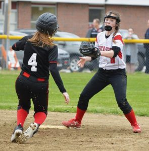WISCASSET SHORTSTOP Kelsey Jones (8) awaits Lisbon base runner Jeanna Turner (4) on a steal attempt at second base. Turner was out on the play.