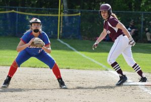MT. ARARAT HIGH SCHOOL first baseman Kate Guerin, left, readies for a ground ball while Edward Little base runner Emily Lashua looks on. Guerin was 3-for-3 at the plate, but Lashua's three-run seventh-inning home run provided the Red Eddies with a 6-1 win.