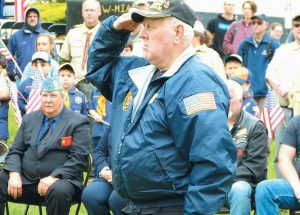 RON DENSMORE, a past post commander, salutes after laying a wreath recognizing the Korean War during the Memorial Day ceremony in Bath's Library Park on Monday.