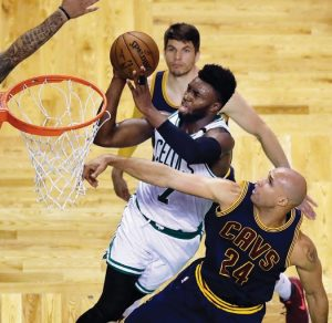 BOSTON CELTICS forward Jaylen Brown (7) drives past Cleveland Cavaliers forward Richard Jefferson (24) during the fourth quarter of Game 1 of the NBA basketball Eastern Conference finals on Wednesday in Boston.