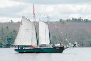 THE MARY E is seen on her arrival to Maine Maritime Museum in Bath on April 24 in the above Times Record file photo. The schooner will be out of water and available for tours and shipbuilding lessons on Community Day. Below, folks gather at the docks to catch the ferry at Maine Maritime Museum in Bath during last year's Community Day in a photo provided by the museum.
