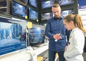 SALOME SIGURJONSDOTTIR, 10, tests a voice-controlled television in an electronics store in Reykjavik. Sales assistant Einar Dadi said none of his TVs understood Icelandic.