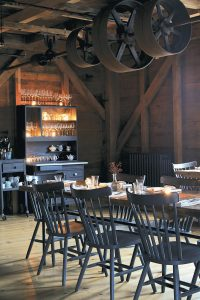 THIS PHOTO shows the interior of The Lost Kitchen, a 40-seat restaurant located in a restored 19th century mill in the tiny town of Freedom, Maine.