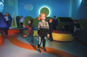 THIS PHOTO shows Ryan Cunningham in the sensory room at Shannon Airport in Shannon, Ireland. Shannon is one of several airports offering quiet rooms for travelers on the autism spectrum.