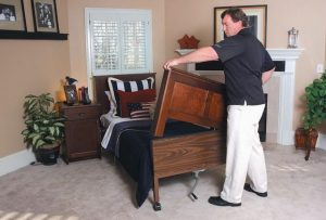 GREG VERLANDER of TenderCare Beds places a custom footboard designed to fit over a hospital bed. He started Tender- Care Beds as a way to bring more normalcy to people who require a hospital bed for sleeping.