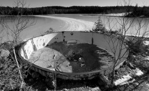 A DETERIORATING TANK sits on the site of the Callahan Mine in Brockville, Maine. The former open pit copper and zinc mine is now a federal Superfund site. Mining companies that once pursued precious metals have abandoned half a million mines across the country and, thanks to decades of lax regulations, left the bill to taxpayers.