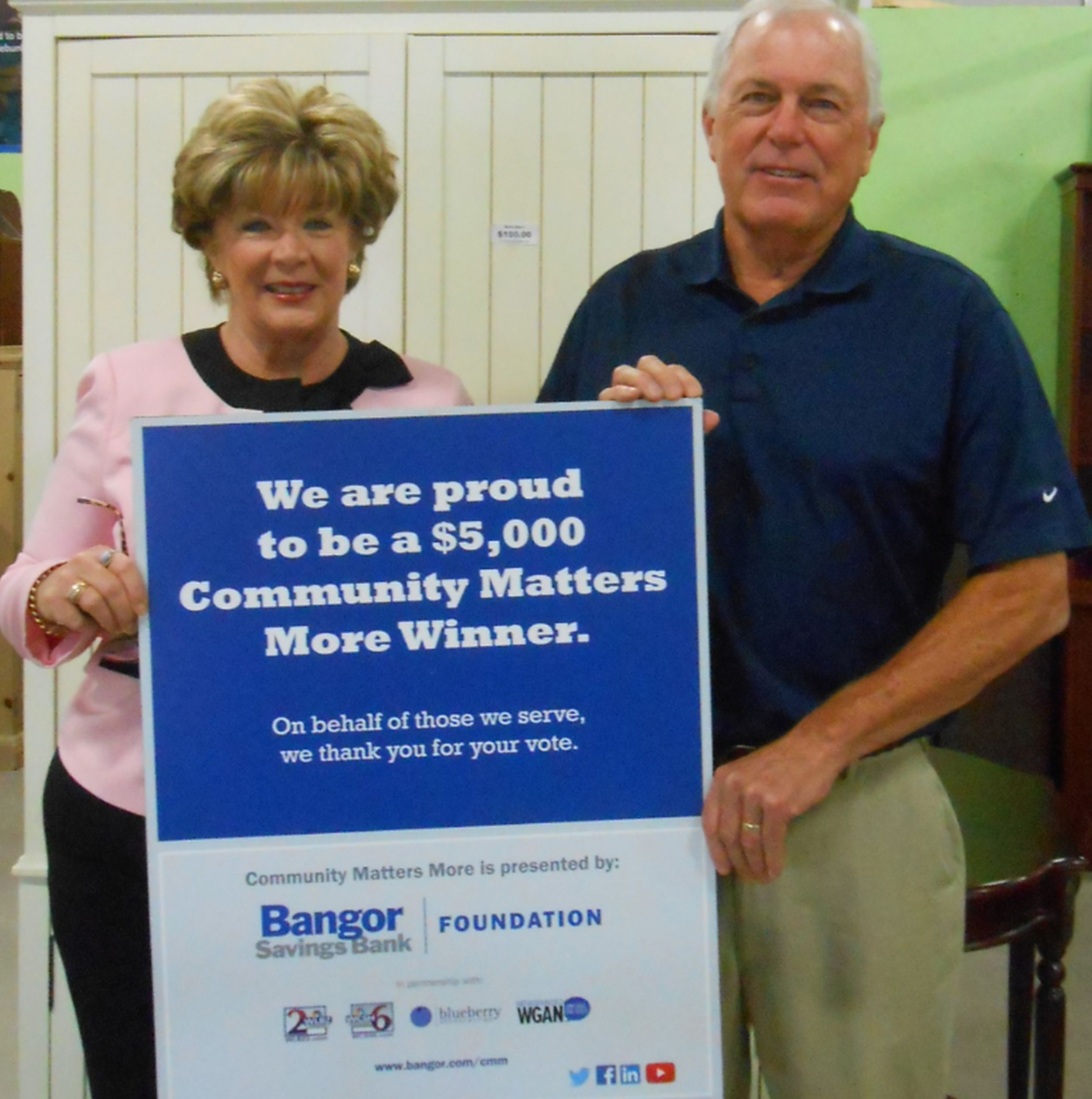 Barbara Conda, Branch Manager of Bangor Savings Bank in York, left, presents a check for $5,000 to Doug Fraser, President of the Board of Directors of Habitat for Humanity York County. SUBMITTED PHOTO
