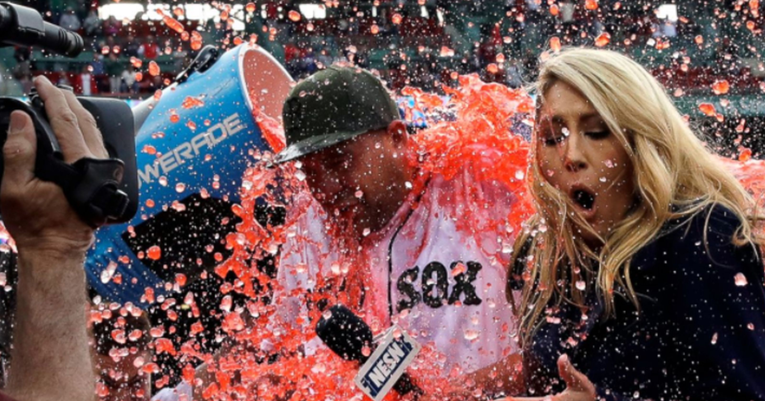 Boston Red Sox starting pitcher Brian Johnson, left, and television field reporter Guerin Austin, are doused after a baseball game against the Seattle Mariners at Fenway Park in Boston, Saturday, May 27, 2017. Johnson threw a complete game. AP WIREPHOTO/Charles Krupa