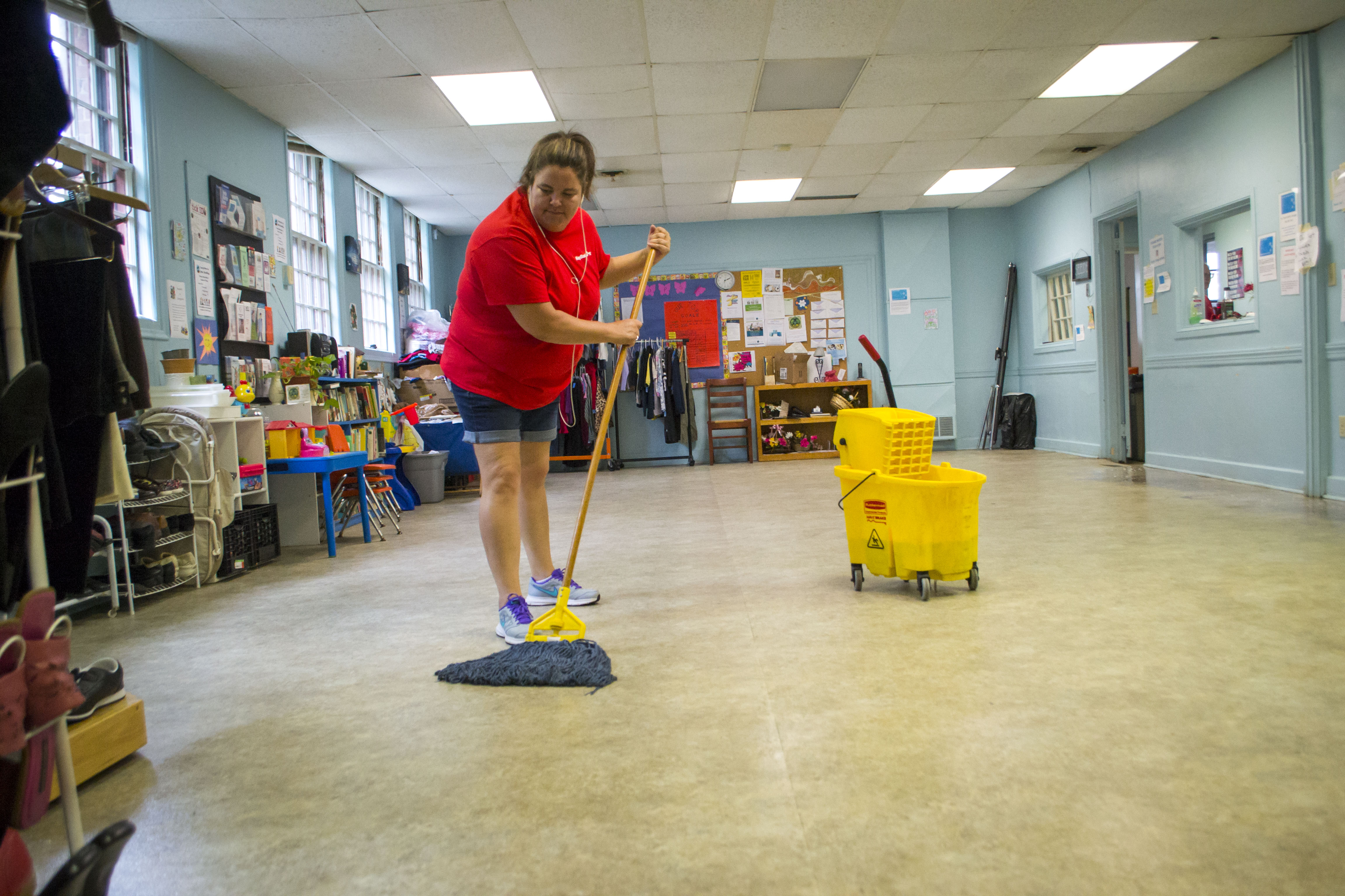 Saco KeyBank employee Michelle Lemelin mops the floors of Biddeford's Seeds of Hope Neighborhood Center as part of statewide efforts for bank employees to give back to their communities Wednesday. ALAN BENNETT/Journal Tribune
