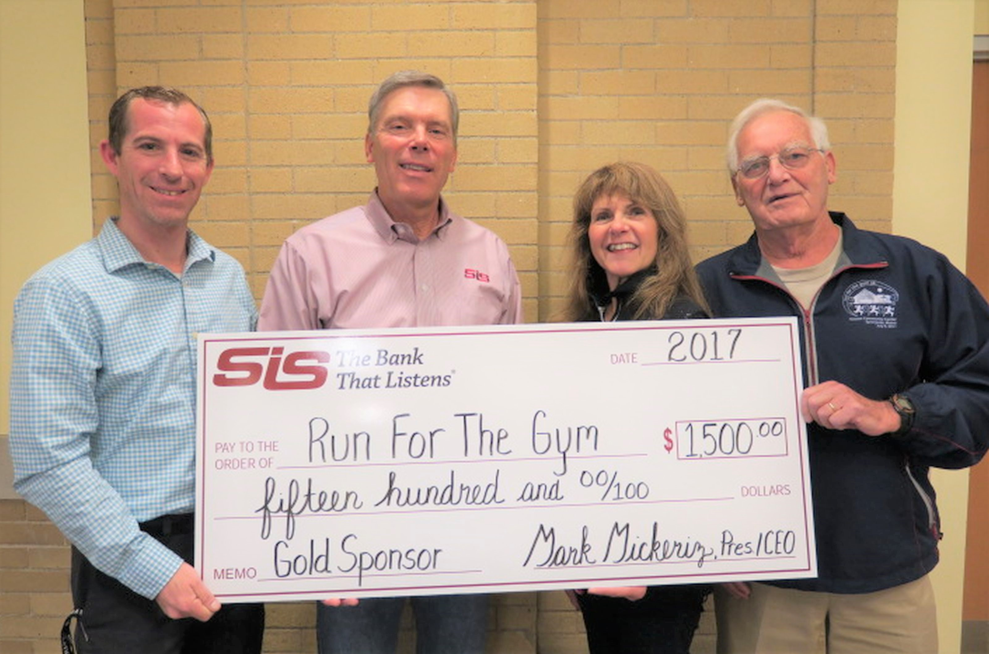 SIS Bank will once more serve as a Gold Sponsor for the annual Randall's 'Run for the Gym 5K' road race, supporting the Nasson Community Center and Little Theater. From left are Lucas Lanigan, Executive Director of Nasson Community Center; Mark Mickeriz, President and CEO of SIS Bank; Linda Nadeau, Executive Administrative Assistant at SIS; and Bob Randall, founder of the Run for the Gym.