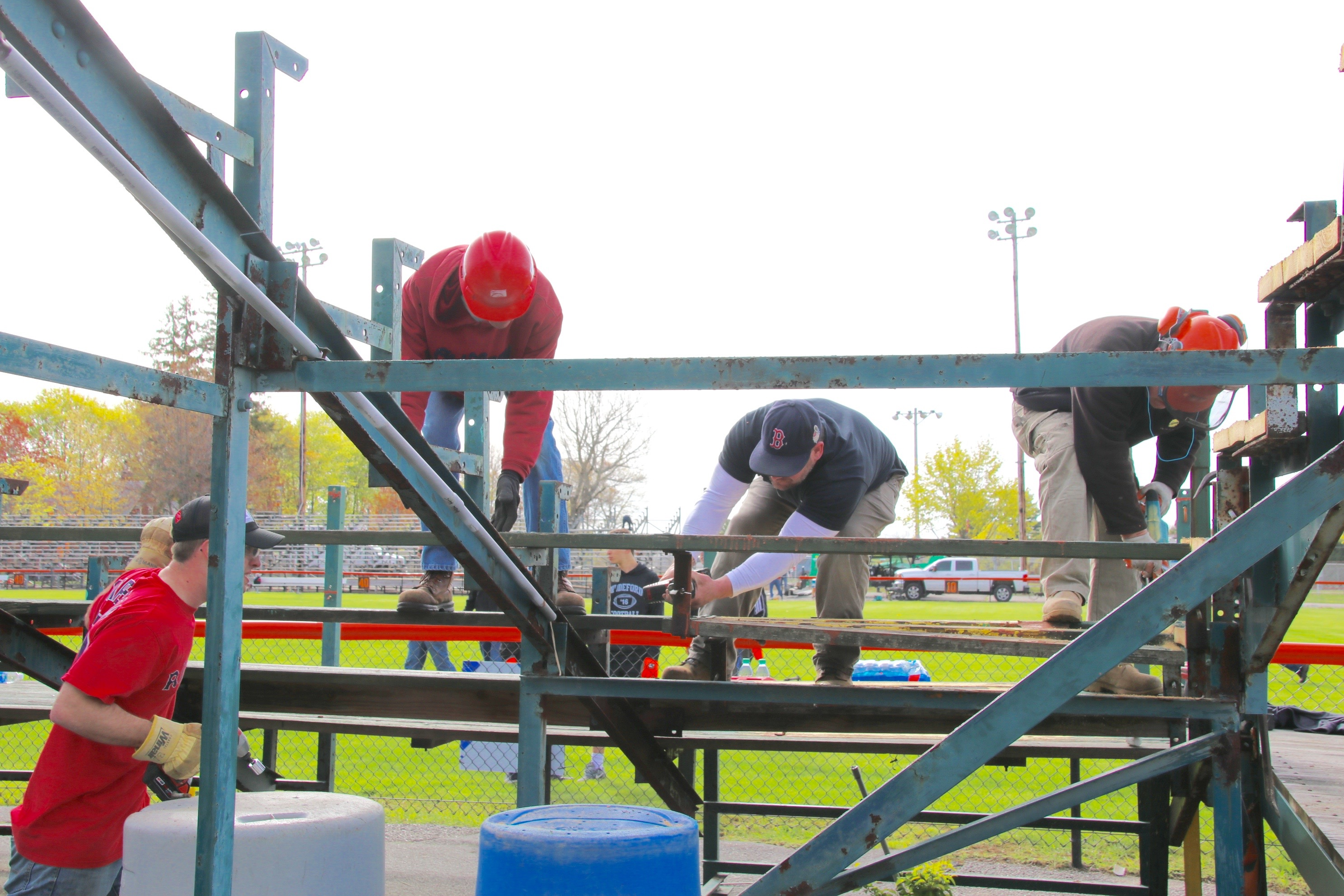 Folks from across Biddeford and beyond came together to dismantle unsafe and worn out bleachers form Waterhouse Field Saturday — a gift which will undoubtedly  make the replacement  project a bit less expensive. TAMMY WELLS/Journal Tribune