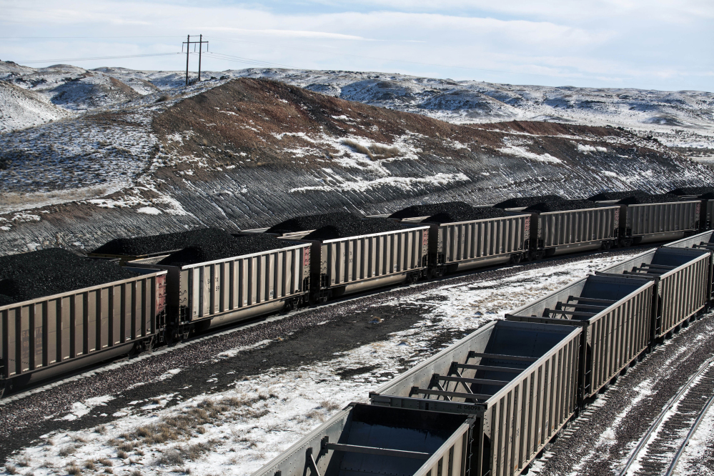 Rail cars filled with coal await transport at Cloud Peak Energy's Antelope Mine north of Douglas, Wyo., in 2014. U.S. coal production fell to 739 million tons last year, the lowest in almost four decades, amid growing competition from natural gas, wind generation and solar power. From 2011 through 2016, the coal mining industry lost an estimated 60,000 jobs.