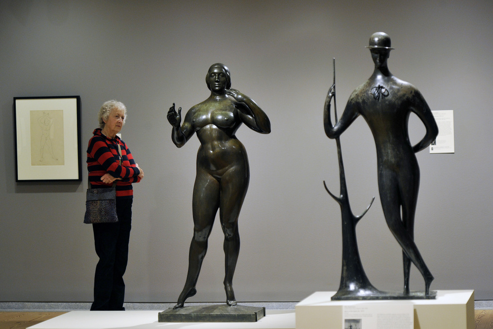 """Claire Keyes of Marblehead, Massachusetts, studies """"Standing Woman,"""" by Gaston Lachaise. At right, """"Man in the Open Air,"""" by Elie Nadelman. Below, """"Spirit of the Dance,"""" by William Zorach."""