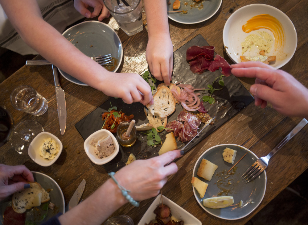 The Murphy family of Scarborough digs into a meat and cheese plate at Northern Union.