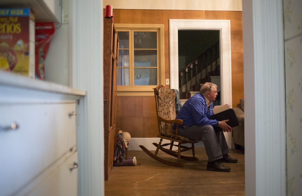 Butch Pratt, truancy officer for Lewiston public schools, listens to Maria Ouellette talk at her home about the struggles of dealing with her 15-year-old daughter's truancy. Pratt often makes house calls and works with parents on trying to deal with their children's absences.