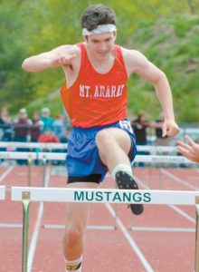 MT. ARARAT'S Matthew Donovan takes on a hurdle during the boys 300 hurdle race.