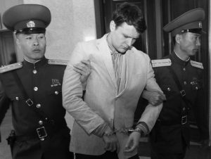 AMERICAN STUDENT OTTO WARMBIER, center, is escorted at the Supreme Court in Pyongyang, North Korea, in 2016. Warmbier, whose parents say has been in a coma while serving a 15-year prison term in North Korea, was released and returned to the United States Tuesday, June 13, 2017, as the Trump administration revealed a rare exchange with the reclusive country.