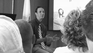 SOMERSET COUNTY CORONER Wallace Miller discusses his role in Sept. 11 for members of a Friends of Flight 93 Series audience at the Flight 93 National Memorial's Learning Center in Shanksville, Pennsylvania.