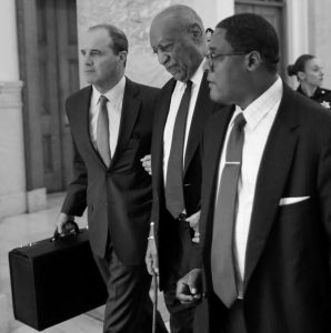 BILL COSBY, second from right, and Defense attorney Brian McMonagle exit the Montgomery County Courthouse during his sexual assault trial Tuesday in Norristown, Pennsylvania.